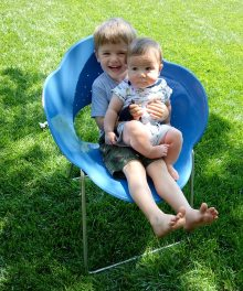 Henry holds Quin in Fleurt chair