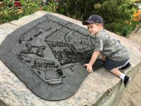 Henry surveys a three-dimensional map of New Amsterdam.
