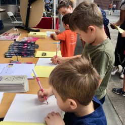 The boys write and illustrate their own books at Writopia Lab kiosk.